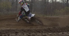 Motocross big dirt kick out in the corner Stock Footage