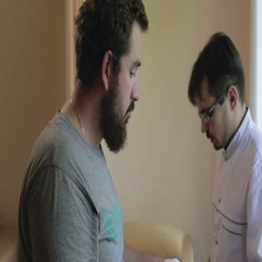 Doctor is bandaging a patient thumb. Bandage and the patch on the arm of the man Stock Footage