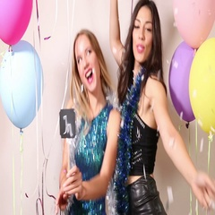 Cheerful friends dancing with a sign in love in party photo booth Stock Footage