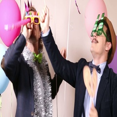 Party guys in photo booth Stock Footage