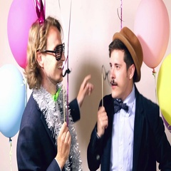 Cheerful male friends dancing in photo booth Stock Footage