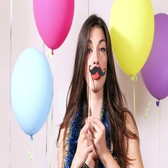 Close up of brunette woman playing with props in party photo booth Stock Footage