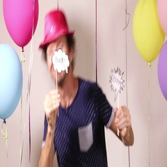 Handsome man dancing in photo booth Stock Footage