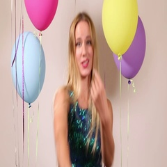Close up of beautiful woman dancing with shiny brace string in photo booth Stock Footage
