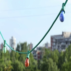 Close up of multicolor string lights at rooftop Stock Footage
