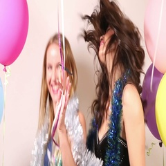 Happy party girls having fun dancing using props in party photo booth Stock Footage