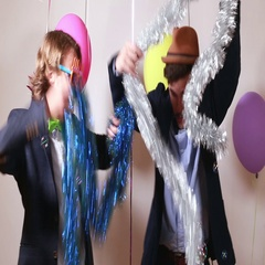 Two friends dancing and giving double high five in photo booth Stock Footage