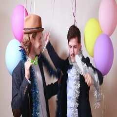 Two friends having fun dancing in photo booth Stock Footage