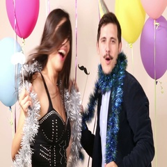 Man and women dancing and making funny faces in photo booth Arkistovideo