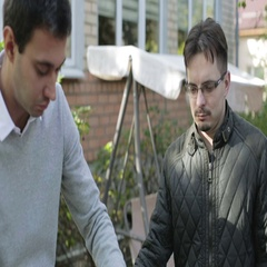 Two guys cook the meat on the grill outdoors. Friends at a barbecue. Stock Footage