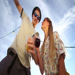 Blonde woman and male hipster looking down at camera and crazy dancing Arkistovideo
