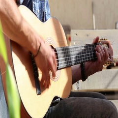 Close view of man's hands playing guitar Stock Footage