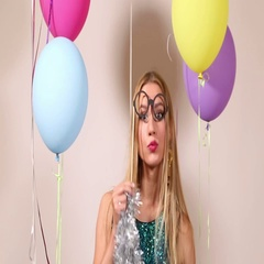 Close up of attractive blonde woman playing with props in photo booth Stock Footage