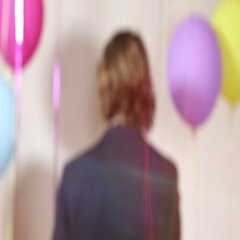 Handsome man playing with props in photo booth Stock Footage