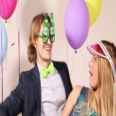 Lovely couple dancing wearing funny props Stock Footage
