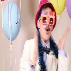 Close up of funny man dancing wearing birthday sunglasses and pink hat Stock Footage