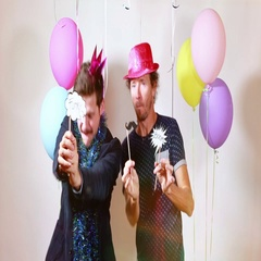 Slow motion of two happy men dancing with props in photo booth Stock Footage