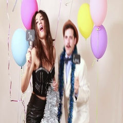 Funny crazy couple in love having fun in photo booth Stock Footage