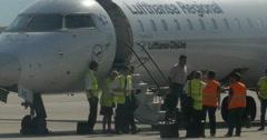 Bombardier CRJ-900LR, Lufthansa regional airplane people leaving plane Stock Footage