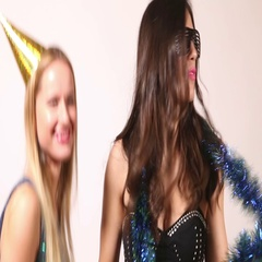 Two beautiful women dancing in photo booth Stock Footage