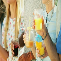 Close up of cheerful friends laughing and toasting at party Stock Footage