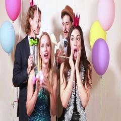 Beautiful friends having fun in party photo booth Stock Footage