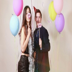 Slow motion of fun crazy couple playing with props in photo booth Stock Footage