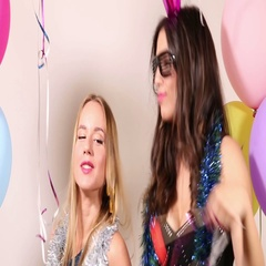 Two beautiful friends having fun dancing in party photo booth Stock Footage