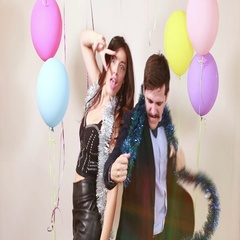 Happy crazy couple enjoying dancing in photo booth Stock Footage