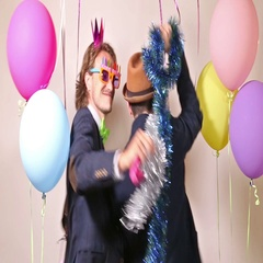 Party guys dancing in photo booth Stock Footage