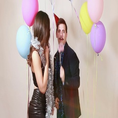 Fun crazy couple playing with props in photo booth Stock Footage
