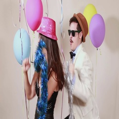 Slow motion of woman and man having awesome time dancing in photo booth Stock Footage
