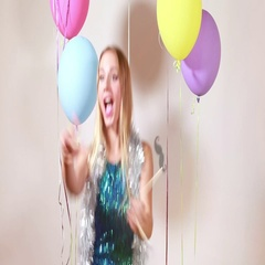 Slow motion of blonde woman having fun in photo booth Stock Footage