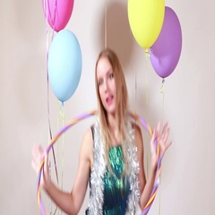 Blonde woman playing with hula hoop in photo booth Stock Footage