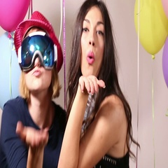Two girls dancing and sending kisses in photo booth Stock Footage