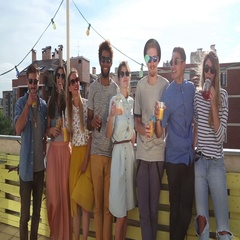 Cheerful multi-ethnic friends standing at rooftop and toasting towards camera Stock Footage