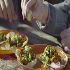 Closeup Of Women Squeezing Lime Juice On Their Tacos At An Outdoor Cafe Stock Footage