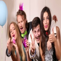 Two cute couples having fun in party photo booth Stock Footage