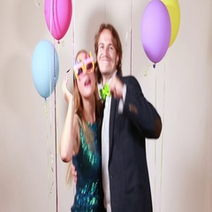Couple dancing funny in photo booth Stock Footage
