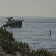 Motor Boat close to shore with Channel islands in backgound. Stock Footage