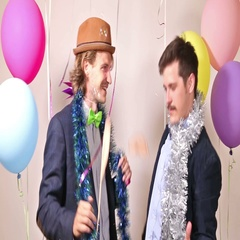 Two male friends dancing in photo booth Stock Footage