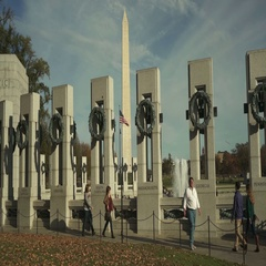 World War 2 Memorial, Washington Monument in background in Washington DC Stock Footage
