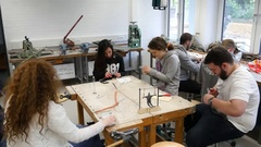Students in art class create a work of art Stock Footage