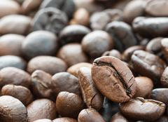 Heap of roasted brown coffee beans Stock Photos