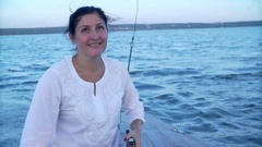 Happy woman at the helm of a yacht in the open sea. Happy Traveling in the Sea Stock Footage