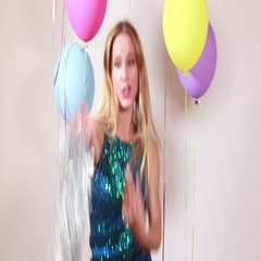 Blonde woman dancing with shiny brace string in photo booth Stock Footage