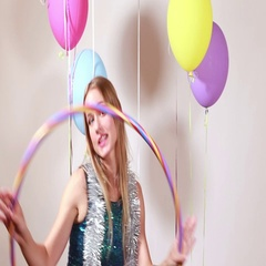 Young woman with hula hoop in photo booth Stock Footage