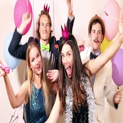 Group of young friends having a great time in party photo booth Stock Footage
