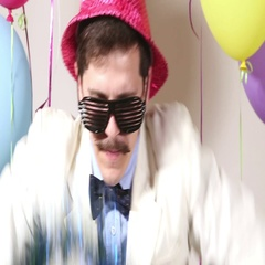 Close up of happy man with pink hat dancing in photo booth Stock Footage