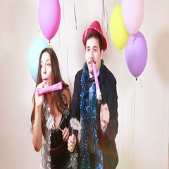 Crazy couple dancing and blowing party horns Stock Footage